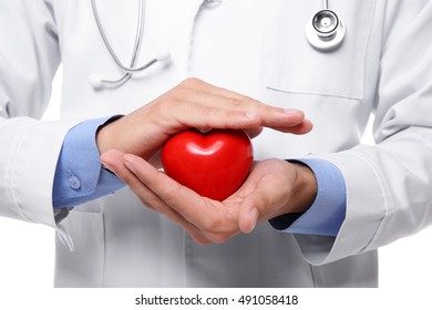 Male doctor holding red heart in hands, closeup
