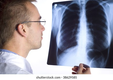 male doctor holding x-ray image on white background