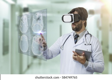 Male doctor at a hospital, using a Virtual Reality Glasses, looking at a virtual screen.
