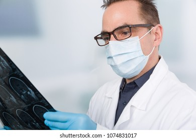 male doctor looks on an x-ray image
