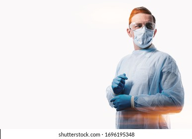 male doctor in a medical mask on his face and gloves on a white background