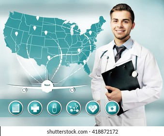 Male doctor and medicine icons on virtual screen. Medical tourism concept