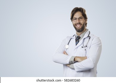 Male doctor on a gray background smiling