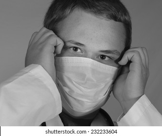 Male Doctor Puts On Mask