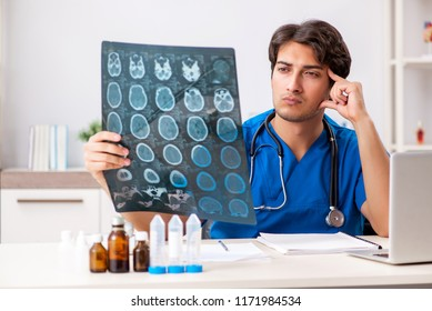 Male doctor radiologist with x-ray can image