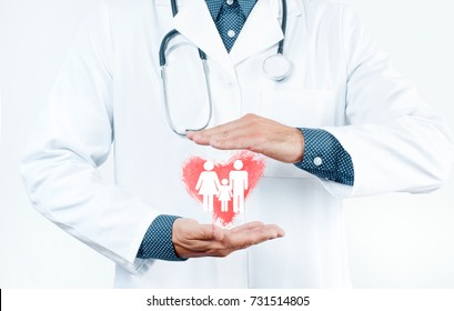 Male Doctor is showing heart shape. Family Insurance Concept