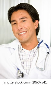 male doctor smiling in a hospital - latin american