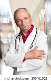 Male doctor with stethoscope at the hospital