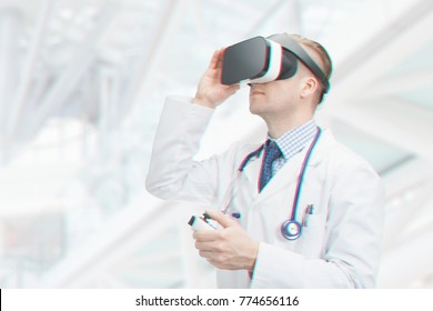 Male doctor testing virtual reality glasses - indoors shot