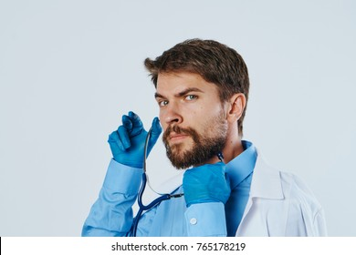 male doctor in uniform ready to use his stethoscope.