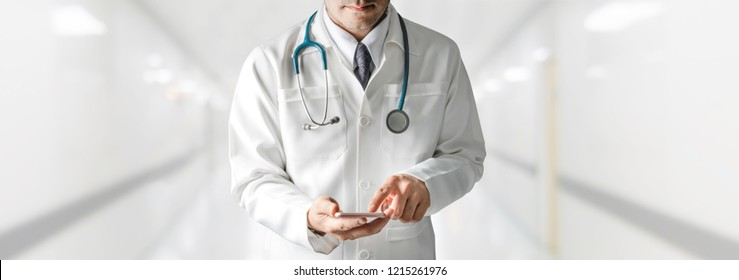 Male doctor using mobile phone at hospital. Medical healthcare and doctor service.