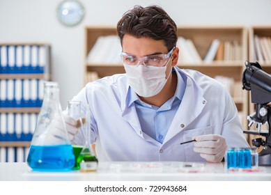 Male doctor working in the lab on virus vaccine