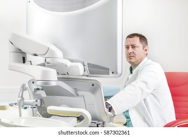 Male doctor wperforming echocardiography exam