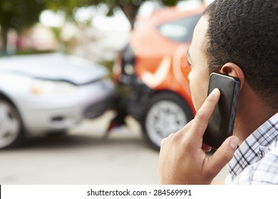 Male Driver Making Phone Call After Traffic Accident