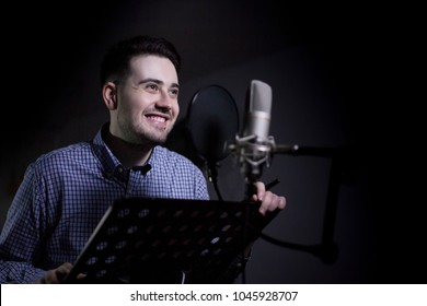 male dub actor performing in dubbing room and smile