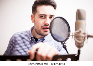 male dub actor performing in dubbing room and look camera