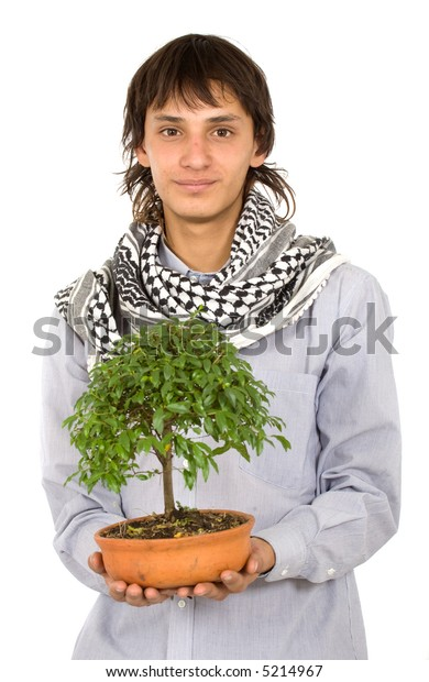 male ecologist holding a tree in his hands over a white background