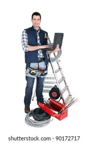 Male electrician with a laptop