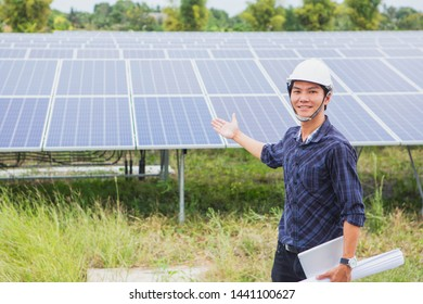 The male employee maintenance panels collect solar energy. Engineer working on checking and maintenance equipment at industry solar power.