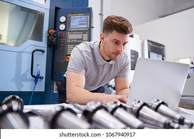 Male Engineer Using CAD Programming Software On Laptop