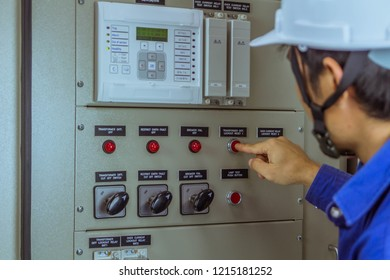 Male engineers are press button switch for check electrical system working.