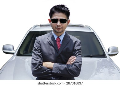 Male entrepreneur wearing formal suit and standing in front new car, isolated on white