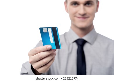 Male executive showing his credit card, focus on card.