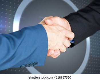 Male executives shaking hands against grey dot on technical background with pixels