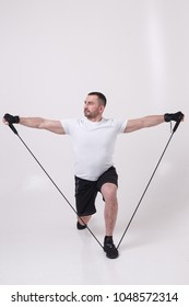 Male exercisers on the cyclorama. Makes techniques from yoga, Pilates, qigong, callanetics hiit, in the shape of a triangle, war,