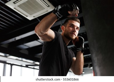 Male exercising in boxing gloves