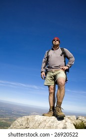 A male experienced Mountain guide observing from the summit