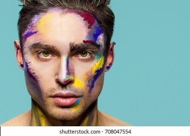 Male face, makeup art. Handsome caucasian man close up. The bold look.