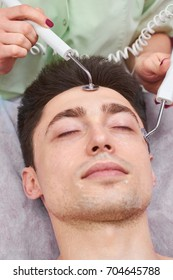 Male face, microcurrent therapy. Guy at the cosmetician. How effective is skin electrotherapy.