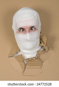 Male face on bandage put out in carton hole