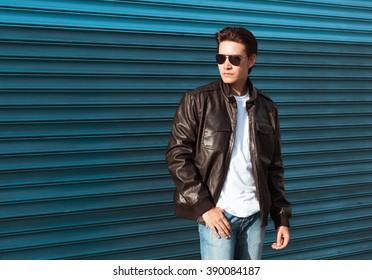 Male fashion model wearing leather jacket.