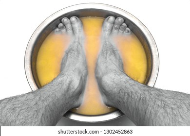 male feet in a basin with mustard soars his legs, on a white natural background