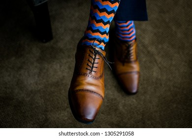 male feet in beautiful shoes and socks