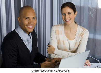 Male and female business executives working together in office.