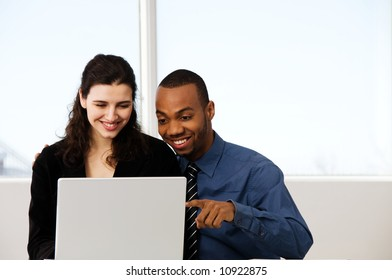 male and female business partners in a window office