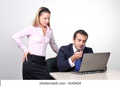 A male female business team working together on the computer.