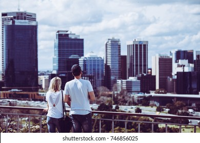Male and female couple looking at landscape