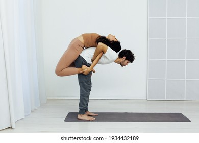 Male and female doubles yoga asana gymnastics fitness