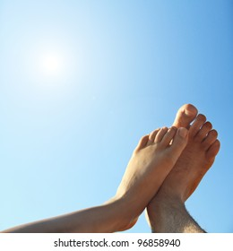male and female foot high direction sky