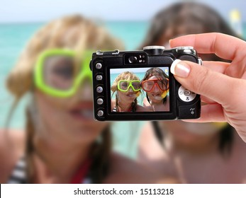 male and female getting a photograph taken while snorkeling in the tropics