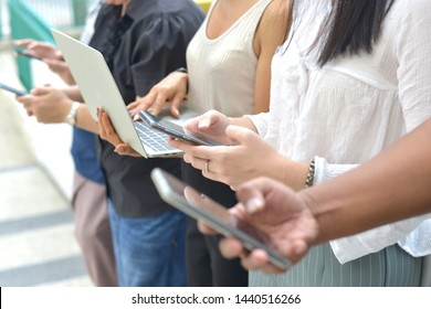 Male and female groups use smartphones, laptops and space outdoor; Lifestyle by studying information technology or social networking concepts - images