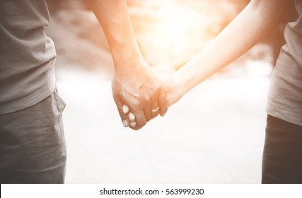 Male and female hand holding each other. Valentine's Day love beautiful concept.