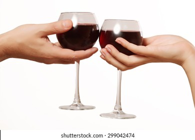 male and female hand holding glasses of red wine, romantic dinner
