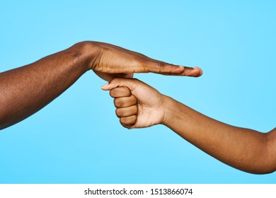 Male female hand holds together attitude studio blue background