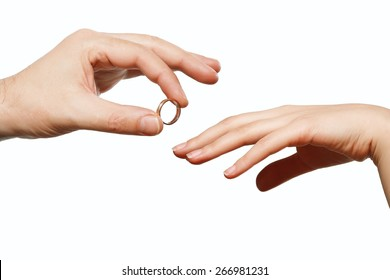 male and female hand with a wedding ring