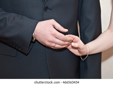 Male and female hand with wedding rings, wedding ceremony